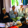 Unidentified Musim senior men pray for Allah for ceremony in Graduation of Quran. — Foto de stock #24552741