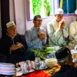 Foto Stock: Unidentified Musim senior men pray for Allah for ceremony in Graduation of Quran.
