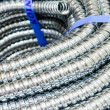 Close up Metal cable protection conduit electric line. — Stock Photo #24804451