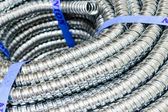 Close up Metal cable protection conduit electric line. — Stock Photo