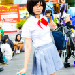 Cosplayer as Japanese schoolgirl poses. — Stock Photo