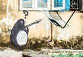 Street Art Graffiti - Penguin hold RPG. — Stock Photo