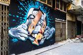 Street Art Graffiti Face on wall some where in Bangkok, Thailand — Stock Photo