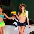 Show Beautiful bikini models wash a car. — Stock Photo