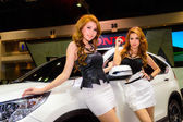 Female presenters model at the Honda booth. — Stock Photo
