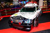 Modified Police Car and screen cartoon japan. — Stock Photo