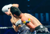 Sudsakorn Sor. Klinmee of Thailand and Dimitri Masson of Switzerland in Thai Fight Extreme 2013. — Stock Photo