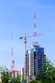 Antenna of Communication Building and modern construction crane. — Stock Photo