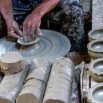 Potter makes on the pottery wheel clay pot. — Stock Photo #30277357