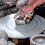 Potter makes on the pottery wheel clay pot. — Stock Photo #30277363