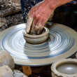 Potter makes on the pottery wheel clay pot. — Stock Photo