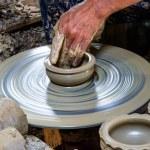 Potter makes on the pottery wheel clay pot. — Stock Photo #30277391