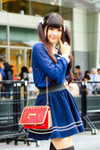 Cosplayer as Japanese schoolgirl poses in Japan Festa in Bangkok 2013. — Stock Photo