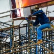 A Construction Worker welding steel bars on scaffold in construction site. — Stock Photo