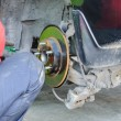 Stock Photo: Auto Mechanic Changing on Car's Disc Brakes.