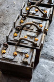 Rusty old train battery in the garage. — Stock Photo