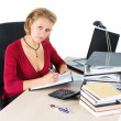 Attractive businesswoman working at busy desk — Stock Photo #11235895
