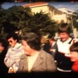 Stock Video: Vintage 8mm. passing through market