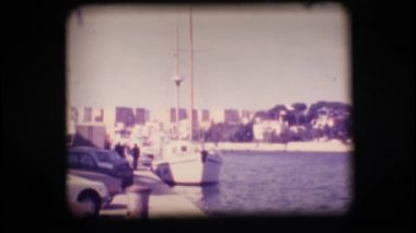 Vintage 8mm. Docked sail boat — Stock Video