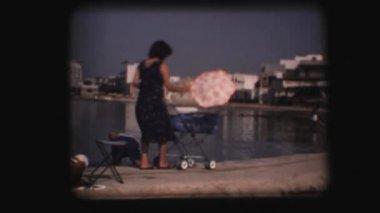Vintage 8mm. Woman pushing stroller — Stock Video