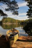 Canoe and calm lake — Stockfoto