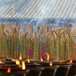 Incense burning in a temple, with candles — Stock Photo