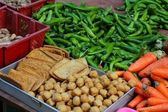 Fresh vegetables and tofu in a Chinese market — Stock Photo