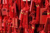 Red Buddhist prayer tablets — Stock Photo