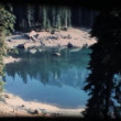 Stock Video: Vintage 8mm. Calm mirroring lake