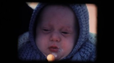 Vintage 8mm. Little baby feeding in his cradle — Stock Video