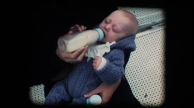 Vintage 8mm. New born baby drinking milk from the bottle — Stock Video