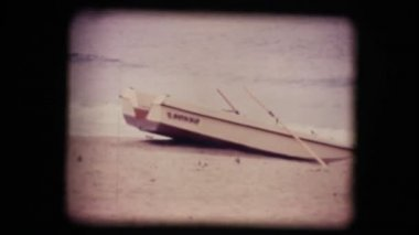 Vintage 8mm. Boat on a empty beach in winter — Stock Video