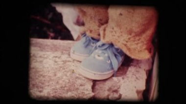 Vintage 8mm. Shoes of a little baby — Stock Video