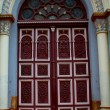 Decorated door of a church - Stock Photo