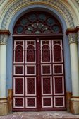 Decorated door of a church — Stock Photo