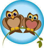 Owls sitting on a branch. — Stock Vector