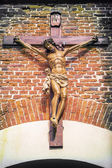 Jesus christ on the cross in front of wall — Stock Photo