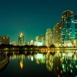 Stock Photo: City downtown at night with reflection of skyline,Emerald green