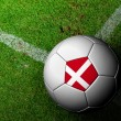 Denmark Flag Pattern of soccer ball in green grass — Stockfoto #29105715