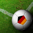 Germany Flag Pattern of soccer ball in green grass — Stockfoto #29107479