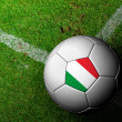 Italy Flag Pattern of soccer ball in green grass — Stockfoto #29107977