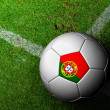 Portugal Flag Pattern of a soccer ball in green grass — Stock Photo