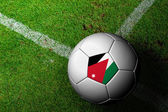Jordan Flag Pattern of a soccer ball in green grass — Stock Photo