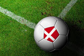 Denmark Flag Pattern of a soccer ball in green grass — Stock Photo
