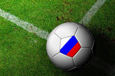 Russia Flag Pattern of a soccer ball in green grass — Stock Photo