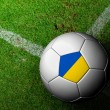 Foto Stock: Ukraine Flag Pattern of soccer ball in green grass