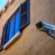 Stock Photo: Windows with cctv on wall