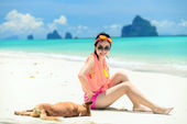 A portrait of beautiful asian woman on relaxing the beach with dog — Stock Photo
