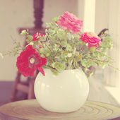 Flowers in vase vintage tone — Stock Photo