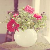 Flowers in vase vintage tone — Stock Photo